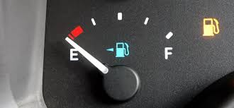 A vehicle fuel guage showing empty, to illustrate the old way of being we want to transition away from